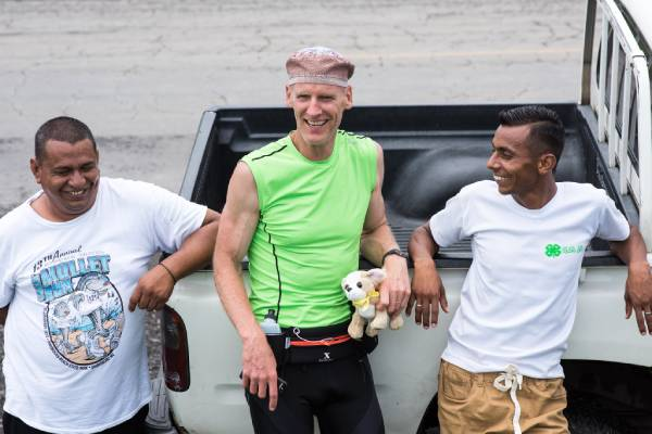 three men in athletic clothes laughing