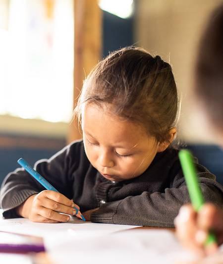 preschool girl writing on notebook