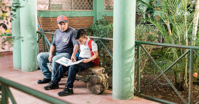 student studying with his father